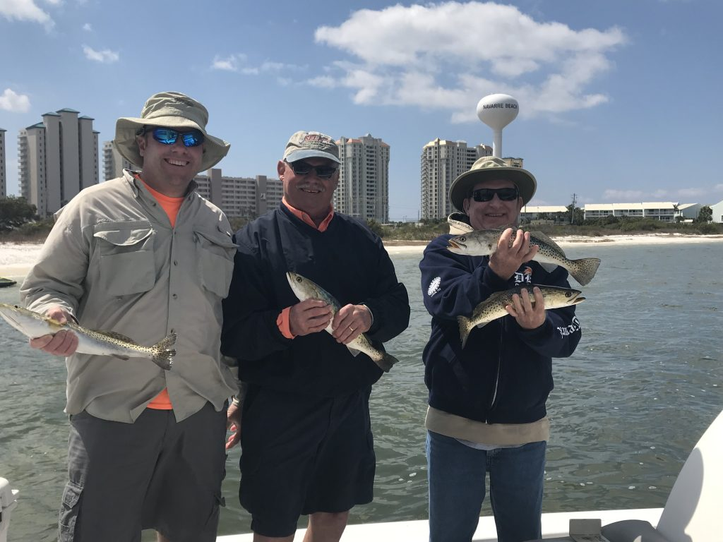 Fishing Charters Near Gulf Breeze Florida. Catching Speckled Trout in Santa Rosa Sound.